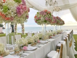 Flowers on table under tent on beach